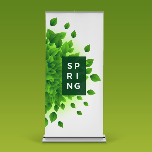 A roll up banner with swirling leaves and the word