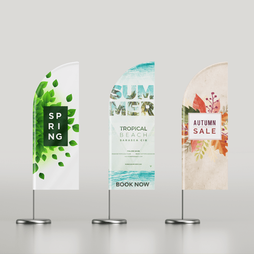 Three flag banners, each mounted on a metal stand. All flags represent a certain season: summer, spring and fall respectively